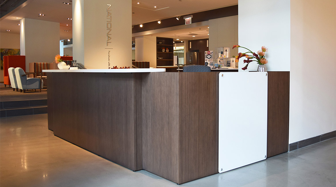 WaveWorks reception desk modified with Corian transaction counter. Also, modified in length.