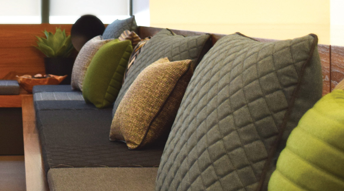 Toss pillows shown with Stitch-it.